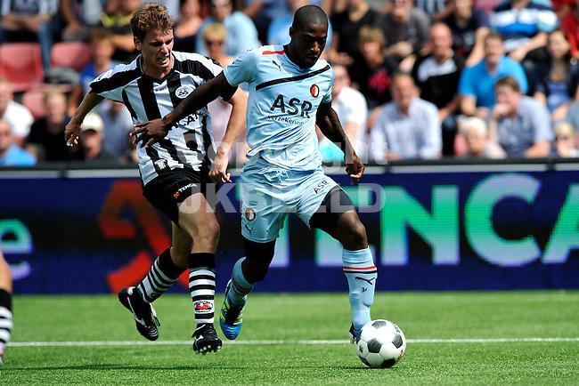 ALMELO - Voetbal, Heracles - Feyenoord , Polmanstadion, Eredivisie, seizoen 2011-2012, 21-08-2011 Feyenoord speler Ruben Schaken (r) op weg naar de 1-1  door Feyenoord speler Guyon Fernandez. Links Heracles Almelo speler Tim Breukers.