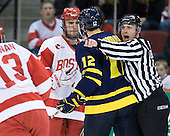 Adam Clendening (BU - 4), Brandon Brodhag (Merrimack - 12), Bob Bernard - The visiting Merrimack College Warriors tied the Boston University Terriers 1-1 on Friday, November 12, 2010, at Agganis Arena in Boston, Massachusetts.