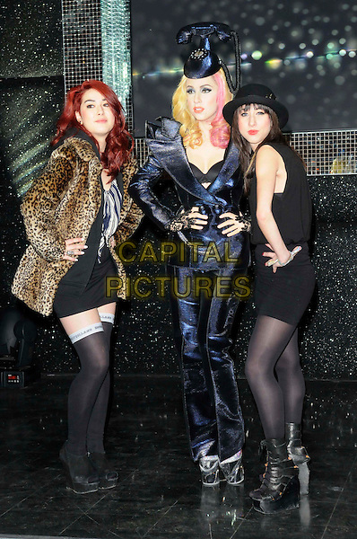 LADY GAGA WAXWORK (C) & FANS Yvonne Phan &  Lidia Chinule.Madame Tussauds unveils their new Lady Gaga Waxwork. The figure is one of seven other attractions around the World (New York, Las Vegas, Hollywood, Amsterdam, Berlin, Shanghai anf Hong kong) each revealing a different style. The London figure wears Philip Treacy telephone hat..Madame Tussauds, London, England, UK, 9th December 2010.full length costume black hands on hips pink hair wig lace fingerless gloves jacket leopard print fur coat stockings otk knee high socks suit wax model figure .CAP/DH.©David Hitchens/Capital Pictures.