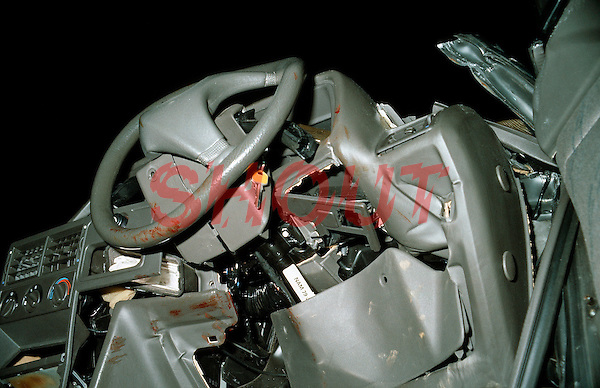 Remains of crashed car after road traffic accident. The steering wheel is bent from the pressure the driver applied just before the crash...© SHOUT. THIS PICTURE MUST ONLY BE USED TO ILLUSTRATE THE EMERGENCY SERVICES IN A POSITIVE MANNER. CONTACT JOHN CALLAN. Exact date unknown.john@shoutpictures.com.www.shoutpictures.com..