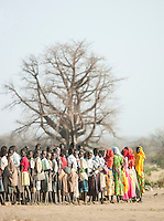 School children and teachers in the Nuba tribe in the village of Nyaro, Kordofan region, Sudan