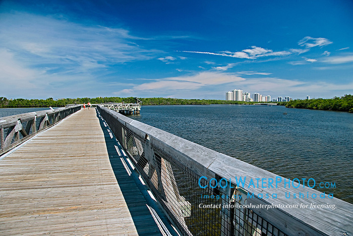 1,600-foot boadwalk bridge across Lake Worth, a preserved, pristine estuary, and high-rise condominiums and hotels on Singer Island in distance, John D. MacArthur Beach State Park, North Palm Beach, Florida