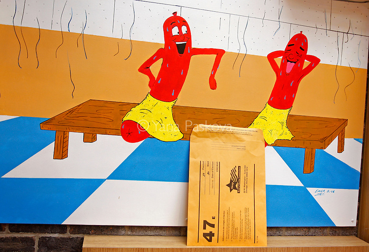 A voting envelope sits on a sill underneath a hot dog picture at a polling place --U Lucky Dawg restaurant selling Chicago-style hotdogs in Chicago, Illinois -- on Super Tuesday, Feb. 5, 2008. (Photo by: Yana Paskova for The New York Times)..Assignment ID: 30056388A..                                 ...........