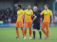 Paul Hayes of Wycombe Wanderers has words with Referee Philip Gibbs during the Sky Bet League 2 match between AFC Wimbledon and Wycombe Wanderers at the Cherry Red Records Stadium, Kingston, England on 21 November 2015. Photo by Alan  Stanford/PRiME.