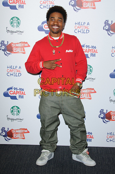 MANN (Dijon Thames Shariff).The Capital FM Summertime Ball, Wembley Stadium, London, England..June 12th, 2011.full length red jacket hands in pockets gold necklace goatee smiling singer rapper artist musician v peace sign jeans denim.CAP/CJ.©Chris Joseph/Capital Pictures.