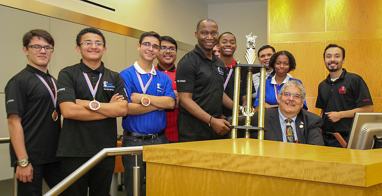 Members of the Chavez High School Chess Team pose for a photograph with Trustee Manuel Rodriguez during a Houston ISD Board of Trustees meeting, June 8, 2017.
