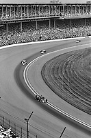 INDIANAPOLIS, IN - MAY 28: Danny Ongais, driving a  Parnelli VPJ6B/VPJ Cosworth, leads a group of cars through Turn 1 during the Indy 500 at the Indianapolis Motor Speedway in Indianapolis, Indiana, on May 28, 1978.