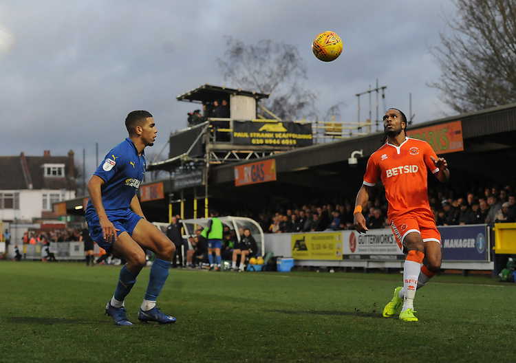 Blackpool's Nathan Delfouneso under pressure from AFC Wimbledon's Terell Thomas<br /> <br /> Photographer Kevin Barnes/CameraSport<br /> <br /> The EFL Sky Bet League One - AFC Wimbledon v Blackpool - Saturday 29th December 2018 - Kingsmeadow Stadium - London<br /> <br /> World Copyright © 2018 CameraSport. All rights reserved. 43 Linden Ave. Countesthorpe. Leicester. England. LE8 5PG - Tel: +44 (0) 116 277 4147 - admin@camerasport.com - www.camerasport.com