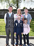 Steven Kelly who received his first holy communion in St Brigid's church Dunleer pictured with parents Alan and Celina and broyhers Dylan and Ryan. Photo:Colin Bell/pressphotos.ie