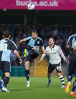 Stephen McGinn of Wycombe Wanderers clears from Ross McCormack of Fulham during the Capital One Cup match between Wycombe Wanderers and Fulham at Adams Park, High Wycombe, England on 11 August 2015. Photo by Andy Rowland.
