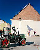 AUSTRIA, Morbisch, kids walk to school and a farmer heads to the fields to harvest grapes, Burgenland