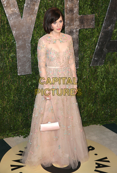 Zooey Deschanel.2013 Vanity Fair Oscar Party following the 85th Academy Awards held at the Sunset Tower Hotel, West Hollywood, California, USA..February 24th, 2013.oscars full length pink white sheer dress pattern floral embroidered bag purse beige.CAP/ADM/SLP/DOW.©Dowling/StarlitePics/AdMedia/Capital Pictures