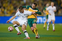 MELBOURNE, AUSTRALIA - MAY 24, 2010: Scott McDonald of the Qantas Socceroos tackles Winston Reid of New Zealand at the FIFA World Cup farewell match between Australia and New Zealand at the Melbourne Cricket Ground, 24 May, 2010 in Melbourne, Australia. Photo by Sydney Low / www.syd-low.com