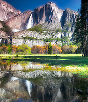 Yosemite Falls reflected in pool of water. Yosemite National Park, California