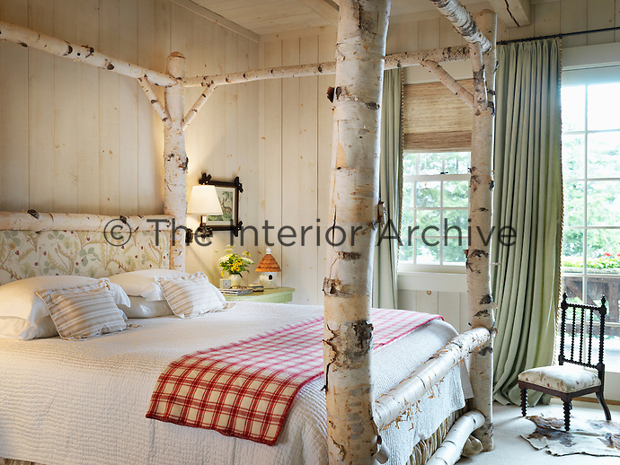 A unique birch trunk four-poster bed complete with peeling bark