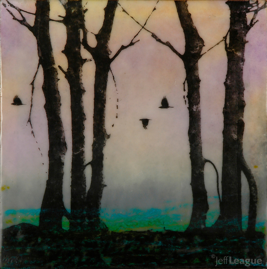 Trees and crows silhouette photo transfer over encaustic painting.