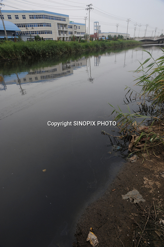 "The river is black and dead in front of paint factories at Xiditou. Xiditou is known as one of China's worse ""cancer villages"" where a reported ten percent have died from cancer."