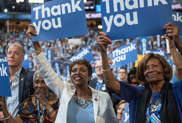 UNITED STATES - JULY 27: Rep. Yvette Clarke, D-N.Y., center, cheers on the floor of the Wells Fargo Center in Philadelphia, Pa., on the third day of the Democratic National Convention, July 27, 2016. (Photo By Tom Williams/CQ Roll Call)