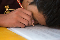 A visually impaired Tibetan student writes Chinese characters during a lesson at the School for the Blind in Tibet, in the capital city of Lhasa, September 2016.