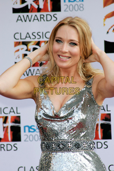 NATASHA MARSH.Arrivals for the Classical Brit Awards 2008 held at the Royal Albert Hall, London, England, UK..May 8th, 2008.half length silver dress shimmery bracelet hands in hair cleavage .CAP/AH.©Adam Houghton/Capital Pictures.