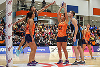 All Stars Maia Wilson looks to grab a point ahead of NZ Men's Matt Wetere during the Cadbury Netball Series match between NZ Men and All Stars at the Bruce Pullman Arena in Papakura, New Zealand on Friday, 28 June 2019. Photo: Dave Lintott / lintottphoto.co.nz