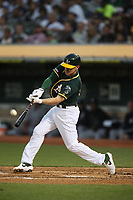 OAKLAND, CA - AUGUST 20:  Corban Joseph #56 of the Oakland Athletics bats against the New York Yankees during the game at the Oakland Coliseum on Tuesday, August 20, 2019 in Oakland, California. (Photo by Brad Mangin)