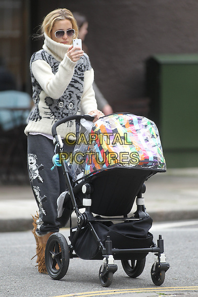 Kate Hudson in Primrose Hill, London, England..May 4th, 2012.full length sunglasses shades white grey gray knitted jumper sweater pushing pram buggy baby kid child mother mom mum mobile phone iphone .CAP/IA.©Ian Allis/Capital Pictures.
