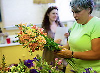 flower farmer Lisa Ziegler working with young woman selecting flowers at Gardeners Workshop