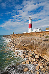 Red and white lighthouse on the coast at Portland Bill, Isle of Portland, Dorset, England