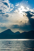 Italy, Veneto, Lake Garda, Brenzone sul Garda: mystic atmosphere at lake Garda, single fishing boat | Italien, Venetien, Gardasee, Brenzone sul Garda: mystische Lichtstimmung ueber dem Gardasee, ein einzelnes Fischerboot auf dem See