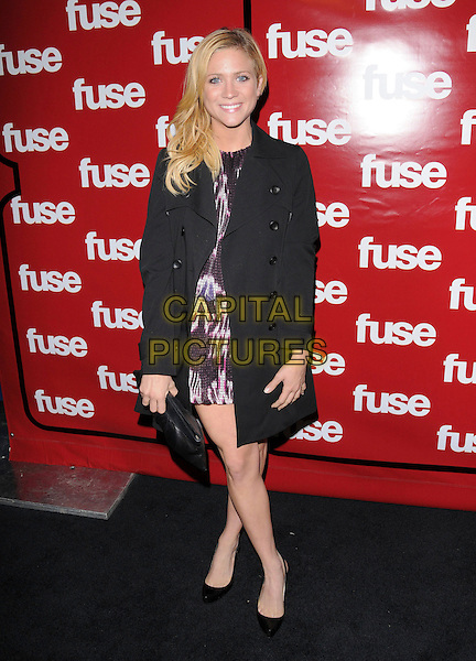BRITTANY SNOW.The 2008 Fuse TV Pre-Grammy Celebration & Concert held at Goa in Hollywood, California, USA..February 7th, 2008                                                                                      .full length black coat jacket dress bag purse clutch .CAP/DVS.©Debbie VanStory/Capital Pictures