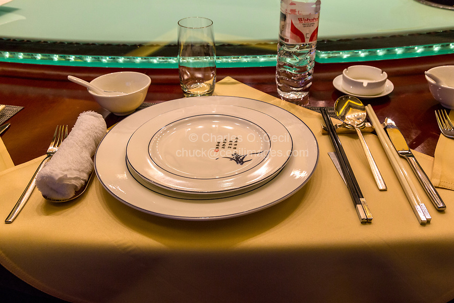 China.  Chinese Table Place Setting with Chopsticks.  Lazy Susan (Rotating Serving Table) in background.