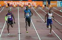 A relaxed Usain BOLT (centre) of Jamaica (Men's 100m) on his way to heat 2 victory in 9.87 during the Sainsburys Anniversary Games at the Olympic Park, London, England on 24 July 2015. Photo by Andy Rowland.