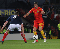 Agim Ibraimi takes on Paul Dixon in the Scotland v Macedonia FIFA World Cup Qualifying match at Hampden Park, Glasgow on 11.9.12.