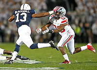 Penn State Nittany Lions wide receiver Saeed Blacknall (13) holds off a tackle by Ohio State Buckeyes cornerback Armani Reeves (26) in the second half at Beaver Stadium on October 25, 2014.  (Chris Russell/Dispatch Photo)