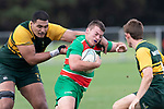 Luke Rosa gets collared by Cameron Skelton. Counties Manukau Premier Club rugby game between Pukekohe and Waiuku, played at Colin Lawrie Fields, Pukekohe on Saturday April 14th, 2018. Pukekohe won the game 35 - 19 after leading 9 - 7 at halftime.<br /> Pukekohe Mitre 10 Mega -Joshua Baverstock, Sione Fifita 3 tries, Cody White 3 conversions, Cody White 3 penalties.<br /> Waiuku Brian James Contracting - Lemeki Tulele, Nathan Millar, Tevta Halafihi tries,  Christian Walker 2 conversions.<br /> Photo by Richard Spranger