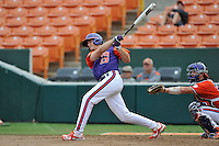Sophomore outfielder Drew Wharton (13) of the Clemson Tigers in a fall practice intra-squad Orange-Purple scrimmage on Sunday, September 27, 2015, at Doug Kingsmore Stadium in Clemson, South Carolina. The catcher is Chris Williams. (Tom Priddy/Four Seam Images)