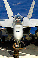 060622-N-7981E-067 Pacific Ocean (June 22, 2006)- A plane captain directs an F/A-18F Super Hornet aircrew as they perform control surface checks prior to takeoff on the flightdeck of the Nimitz-class aircraft carrier USS Abraham Lincoln (CVN-72). Lincoln and embarked Carrier Air Wing (CVW) 2 are currently participating in Operation Valiant Shield 2006, a large-scale joint forces exercise in the Guam operating area. U.S. Navy photo by Photographer's Mate Airman James R. Evans (RELELASED)