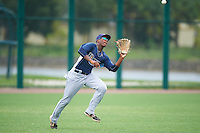 GCL Rays left fielder Ryan Caldwell (9) catches a fly ball during the second game of a doubleheader against the GCL Red Sox on August 9, 2016 at JetBlue Park in Fort Myers, Florida.  GCL Rays defeated GCL Red Sox 9-1.  (Mike Janes/Four Seam Images)
