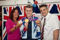 Triple Paralympic medalist Ollie Hynd from Kirkby in Ashfield proudly shows off his 'one of each' collection of swimming medals at ASDA Sutton on Saturday, where he made a personal appearance.  Pictured with Ollie are Community Colleague Hayley Radford and Duty Manager Adrian Stocks