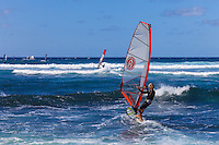 Windsurfers at Ho'okipa Beach on Maui. (NOTE: the man in the foreground is model released, the others are not model released.)
