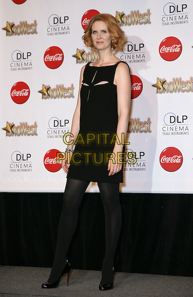 CYNTHIA NIXON .SHOWEST Final Night Talent Awards at the Paris Resort Hotel and Casino,  Las Vegas, Nevada , USA,.18th March 2010..full length black dress cut out slits sleeveless tights shoes christian louboutin heels .CAP/ADM/MJT.© MJT/AdMedia/Capital Pictures.