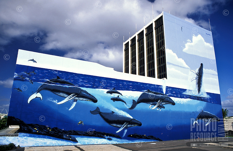 Another spectacular whaling wall from the internationally acclaimed artist Wyland. This giant mural of the Humpback whale is on a building located near the Honolulu Airport and is visible from the highway.