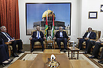 Palestinian Prime Minister Rami Hamdallah speaks with senior Hamas leader Ismail Haniyeh, at Haniyeh's house in Gaza city on October 9, 2014. The Palestinian unity government which took the oath of office in June under technocrat prime minister Rami Hamdallah arrived to Gaza Strip on Thursday to convene the first fully meeting. Hamdallah said that the unity government will rebuild the bombed-out Gaza Strip following a seven-week Israeli offensive. Photo by Ali Jadallah