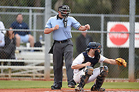 Umpire Mike Savakinas and Georgetown Hoyas catcher Eric Webber during a game against the Illinois State Redbirds on March 7, 2015 at North Charlotte Regional Park in Port Charlotte, Florida.  Illinois State defeated Georgetown 2-1.  (Mike Janes/Four Seam Images)