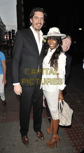 LONDON, ENGLAND - JULY 16: guest &amp; Sinitta attend the Attitude Magazine's World Sexiest Men 2014 summer party, The Paramount Club, 31st floor, Centre Point, New Oxford St., on Wednesday July 16, 2014 in London, England, UK.<br /> CAP/CAN<br /> &copy;Can Nguyen/Capital Pictures