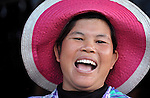 A woman laughs in the village of Dong in northern Cambodia.