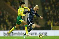 8th November 2019; Carrow Road, Norwich, Norfolk, England, English Premier League Football, Norwich versus Watford; Will Hughes of Watford competes for the ball with Jamal Lewis of Norwich City - Strictly Editorial Use Only. No use with unauthorized audio, video, data, fixture lists, club/league logos or 'live' services. Online in-match use limited to 120 images, no video emulation. No use in betting, games or single club/league/player publications
