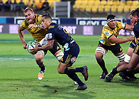Aaron Smith looks to pass during the Super Rugby match between the Hurricanes and Highlanders at Westpac Stadium in Wellington, New Zealand on Saturday, 24 March 2018. Photo: Mike Moran / lintottphoto.co.nz