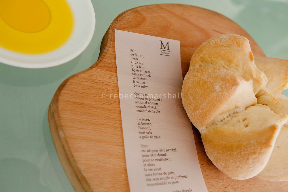 Bread is served with a poem and a dish of olive oil for sharing at restaurant Mirazur, Menton, France, 18 September 2013. The oil, produced locally at the Huilerie St Michel in Menton, is flavoured with lemon and ginger and the recipe is the result of a partnership between the olive oil producer and head chef of Mirazur, Mauro Colagreco.